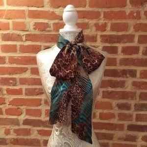 Bebe versatile satin leaped scarf.